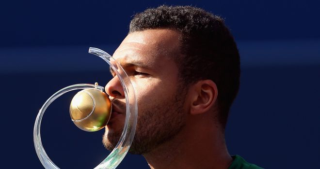 Jo-Wilfried Tsonga kisses the Rogers Cup trophy after his win against Roger Federer