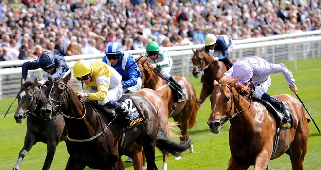 Dutch Connection ridden by William Buick (right) arrives late to nab Tocoolforschool ridden by Ben Curtis to win the Acomb Stakes.