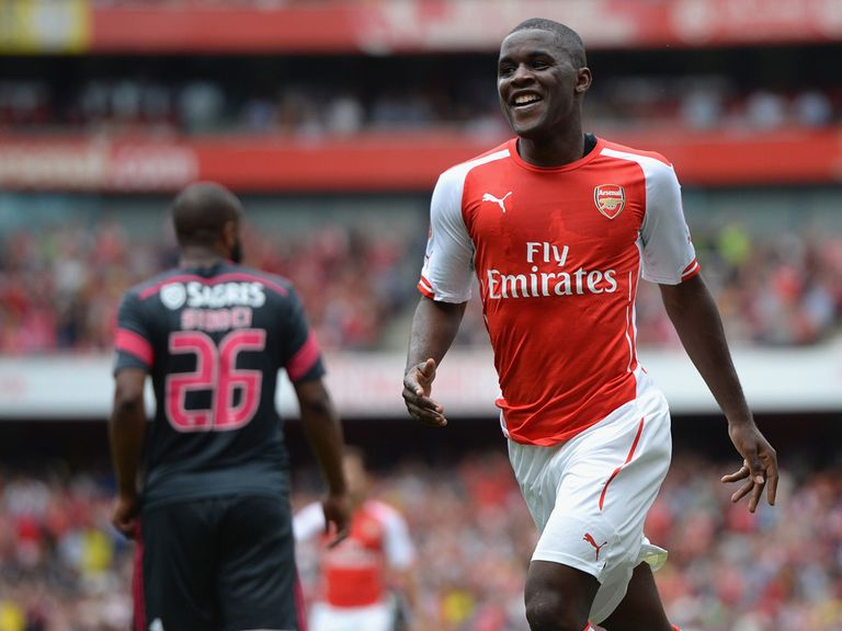 Joel Campbell celebrates his goal for Arsenal against Benfica