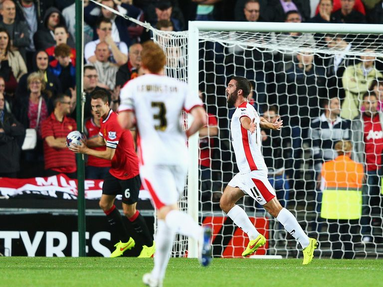 Will Grigg celebrates after putting MK Dons a goal up
