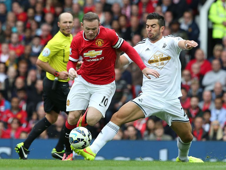 Wayne Rooney in action against Swansea