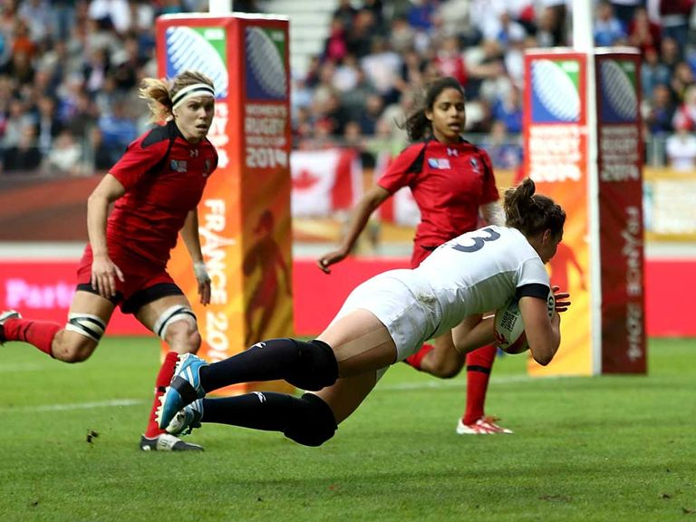 Emily Scarratt of England dives over for a try against Canada
