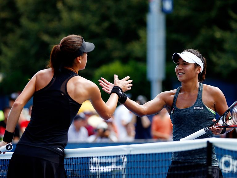 Heather Watson (r) shakes hands with Sorana Cirstea