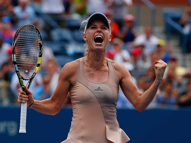 Caroline Wozniacki celebrates after she defeated Maria Sharapova