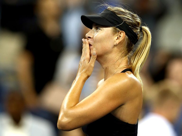 Maria Sharapova of Russia celebrates her win against Sabine Lisicki