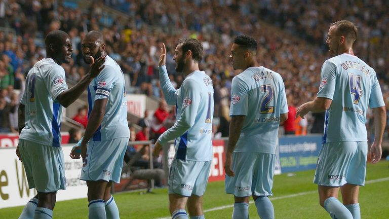 Coventry players celebrate Franck Nouble's winner