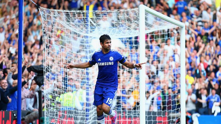 Diego Costa of Chelsea celebrates as scores his third goal against Swansea