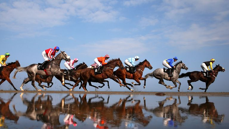 Runners and riders in action during the Barry Matthews Appreciation Society Handicap during Laytown races