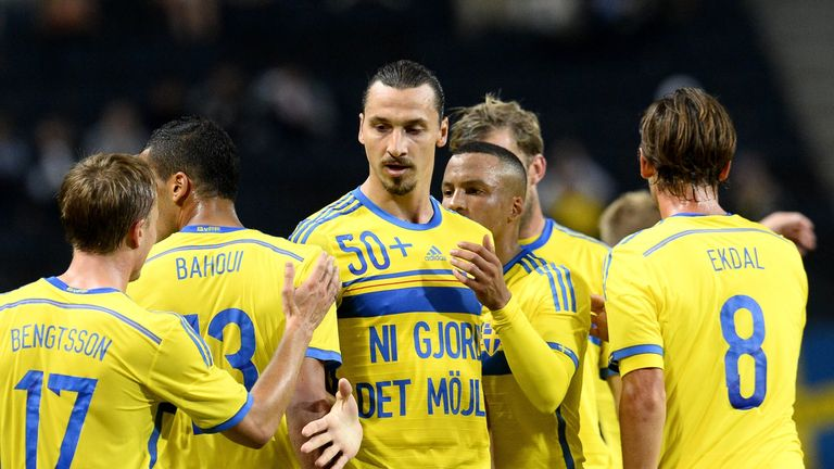 Zlatan Ibrahimovic (c) celebrates with teammates after scoring his second goal against Estonia