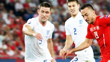 Gary Cahill (l) in action for England against Switzerland