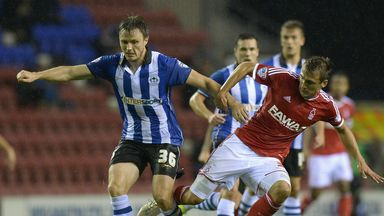 William Kvist (l): Hopes to help Wigan