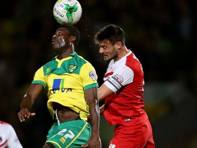 Alexander Tettey and Johnnie Jackson compete for the ball