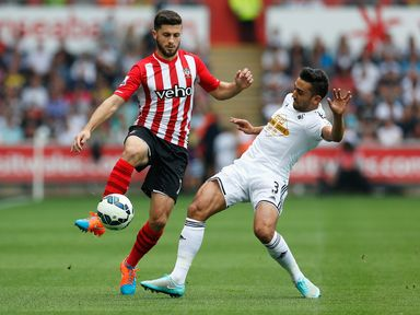 Shane Long is watched by Neil Taylor