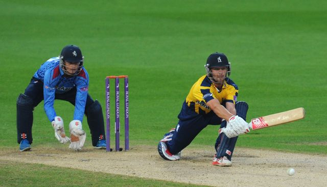 Jonathan Trott: Warwickshire No 3 reverse sweeps during his innings of 58