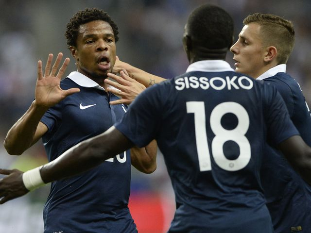 Loic Remy celebrates after scoring against Spain