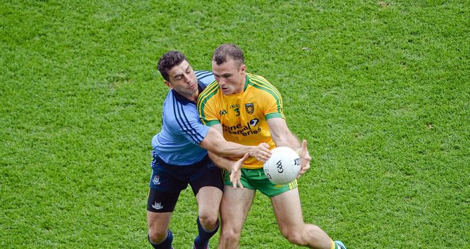 Neil McGee and Bernard Brogan compete for possession during Sunday's All-Ireland semi-final