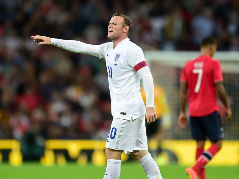 Wayne Rooney gestures to team-mates at Wembley
