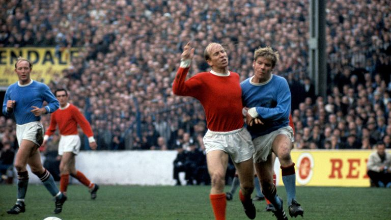 Sir Bobby Charlton in action for Manchester United against rivals City