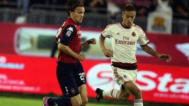 Albin Ekdal of Cagliari and Honda Keisuke of AC Milan battle for the ball
