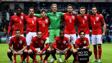 Gary Cahill (third from right): Job done for England in Estonia