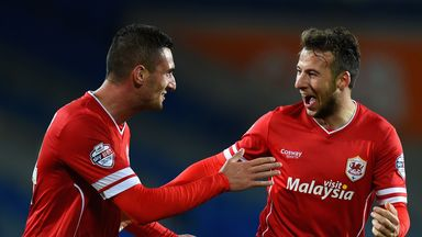 Adam Le Fondre is congratulated by Federico Macheda after scoring Cardiff's third goal