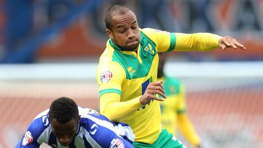 Sheffield Wednesday's Jose Semedo (left) and Norwich City's Lewis Grabban battle for the ball