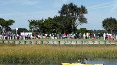 A kayaker watches the action on the 16th hole during the third round of The McGladrey Classic at Sea Island's Seaside Course