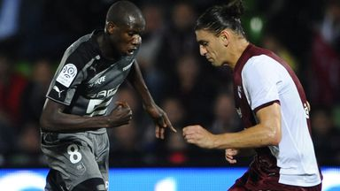Metz defender Guido Milan (right) in action