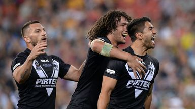 Shaun Johnsonis congratulated by his New Zealand team-mates after touching down
