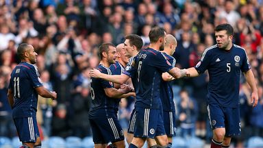 Shaun Maloney and his Scottish teammates celebrate Akaki Khubutia