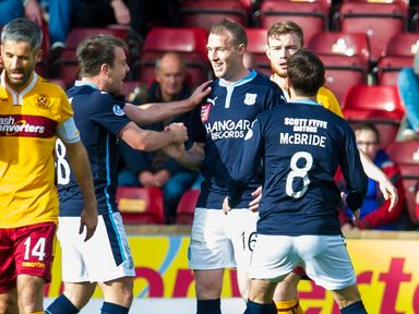 Dundee's David Clarkson mutes his celebration as he puts his side 1-0 ahead
