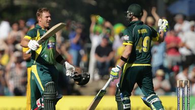 Aaron Finch (left): Celebrates with Steven Smith after reaching his century