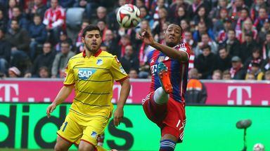 Jerome Boateng clears the ball away from Kevin Volland