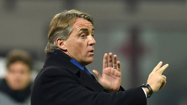 Roberto Mancini issues instructions during Sunday's derby