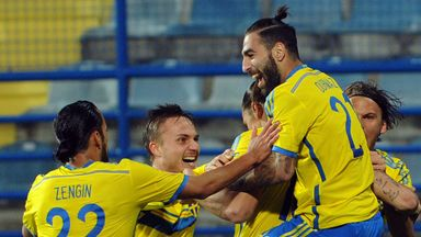 Zlatan Ibrahimovic is mobbed by his team-mates after scoring for Sweden against Montenegro in Podgorica