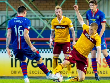 Henrik Ojamaa challanges for the ball with Greg Tansey