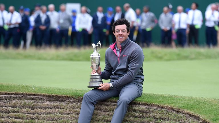 Rory McIlroy celebrates winning his first Open title last year