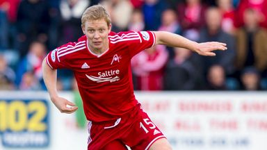 Barry Robson: The veteran midfielder signs a new one-year deal at Pittodrie