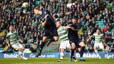 Ross County pair Scott Boyd (2nd from left) and Paul Quinn battle with Celtic's John Guidetti