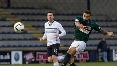 Hibernian's Liam Fontaine strikes from distance.