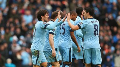 David Silva celebrates the opening goal with Samir Nasri against Crystal Palace
