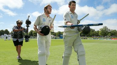Kane Williamson (L) and Ross Taylor walk off the field after the win