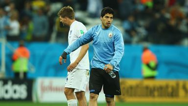Luis Suarez of Uruguay speaks to Steven Gerrard of England after Uruguay's 2-1 victory in the 2014 FIFA World Cup