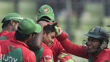Bangladesh cricketers congratulate teammate Taijul Islam (C) after his hat-trick during the fifth and the final one-day international v Zimbabwe