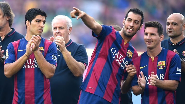 Xavi says Sergio Busquets (centre) can be the next club legend, and describes Lionel Messi (right) as a phenomenon