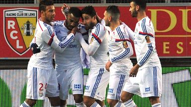 Alexandre Lacazette: Is congratulated by his team-mates after scoring