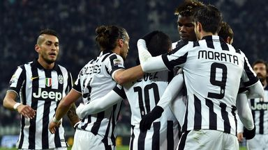 Juventus: Celebrate one of Carlos Tevez's two goals against Hellas Verona