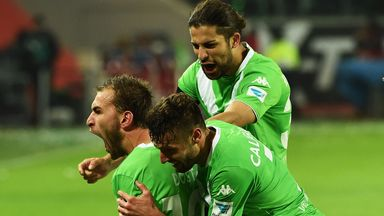 Bas Dost of Wolfsburg celebrate scoring his second goal against Bayern Munich