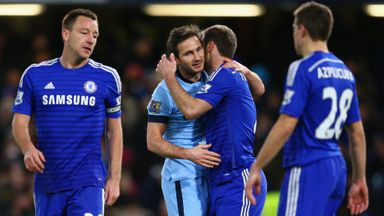 Frank Lampard of Manchester City embraces Branislav Ivanovic of Chelsea