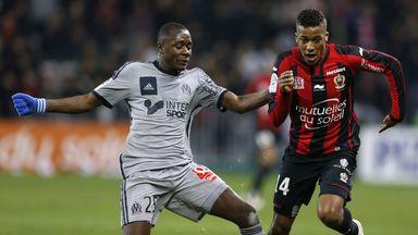 Marseille midfielder Giannelli Imbula (left) challenges Nice's Alassane Plea
